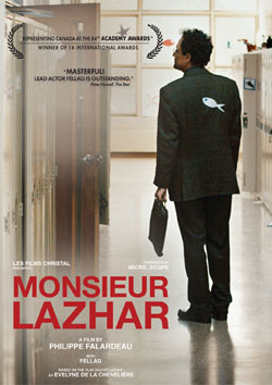 The main character of the film Monsieur Lazhar standing with a folder in his hands
