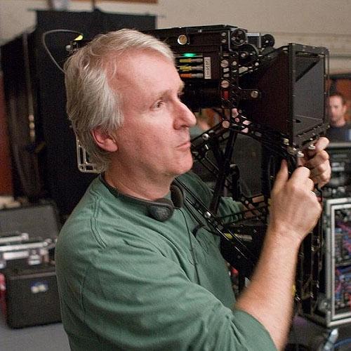 James Cameron holding a movie camera
