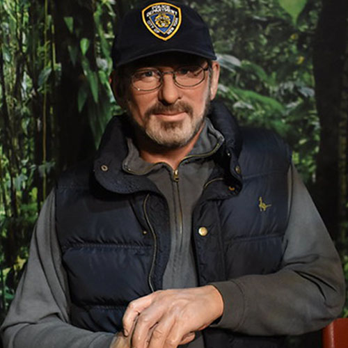 Steven Spielberg on the set of the movie in a cap